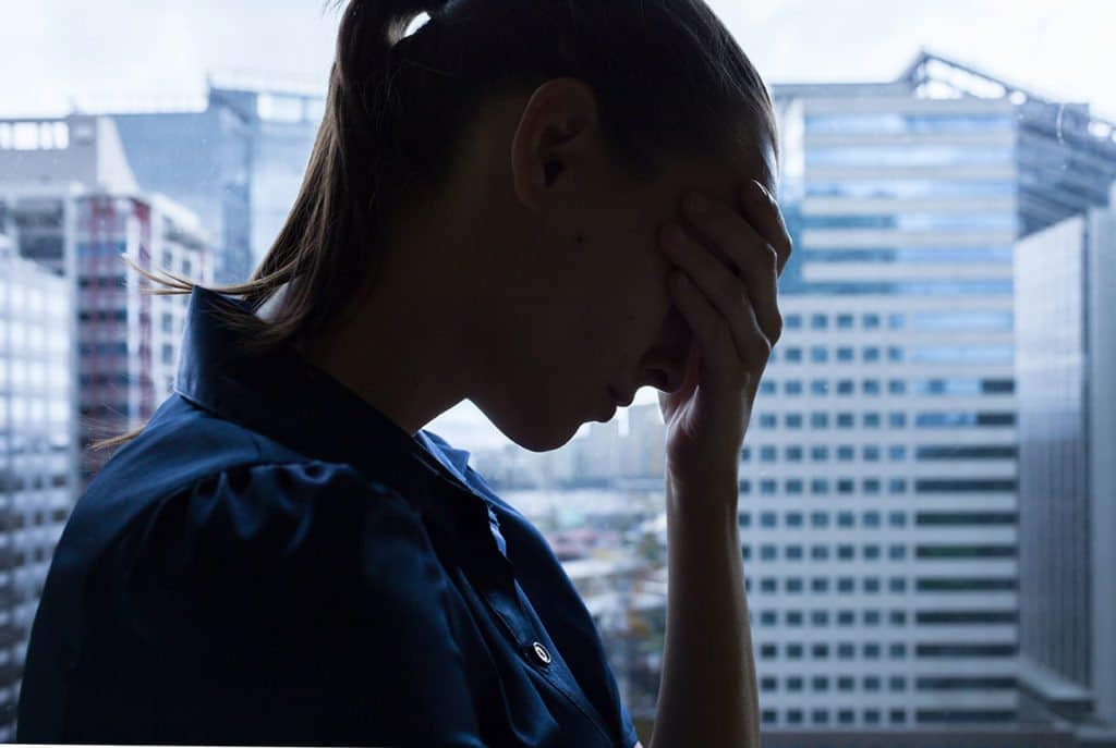 Stressed Woman Needs to Talk to Her Bankruptcy Lawyer