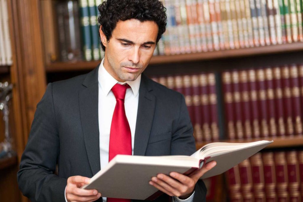 bankruptcy attorney looks over bankruptcy law book
