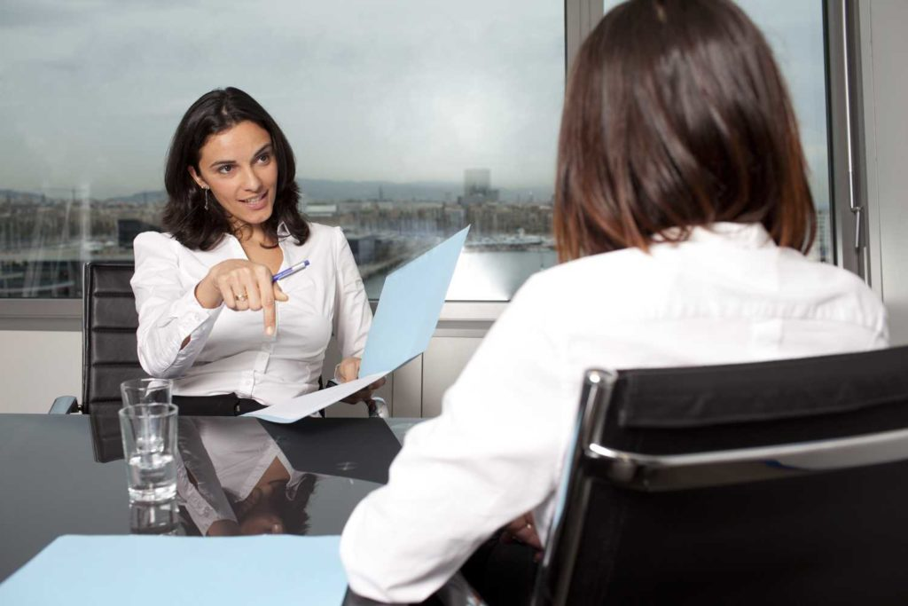 Woman asks questions about Chapter 13 bankruptcy to her lawyer