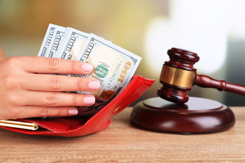 Bankruptcy attorney with money and gavel