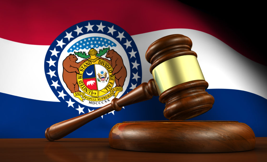 Missouri flag behind a gavel