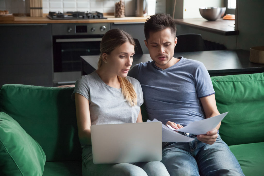 Worried couple discussing financial problems