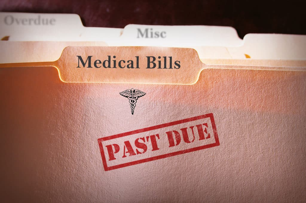 File folders with past due medical bills