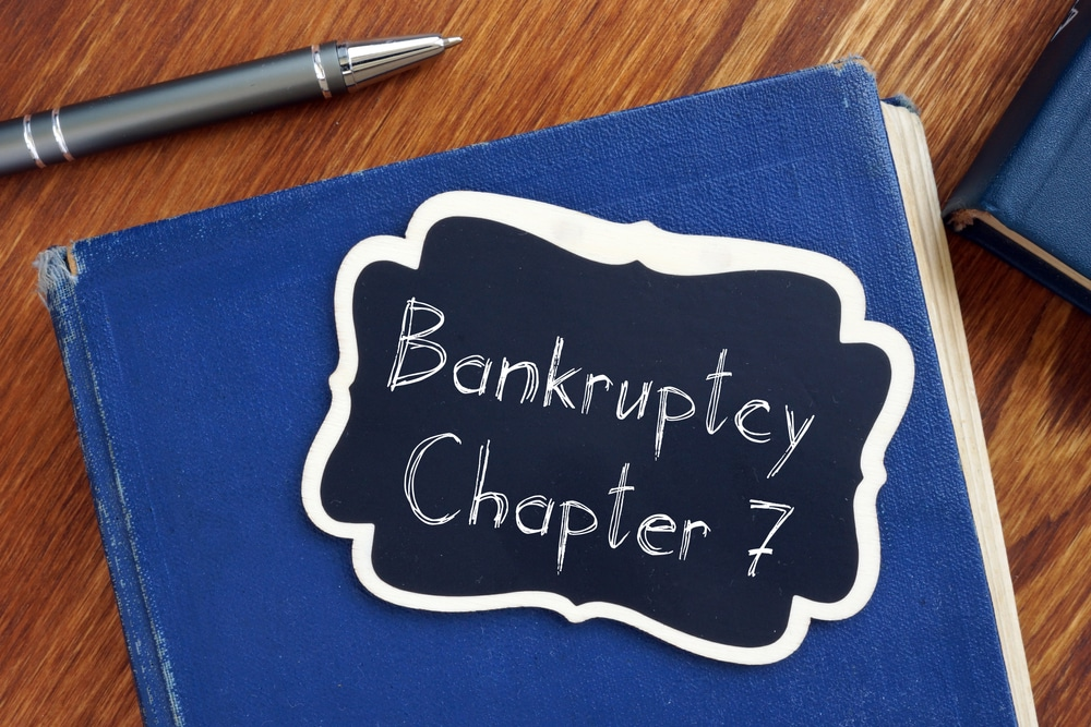 Old book with Bankruptcy Chapter 7 note written on it
